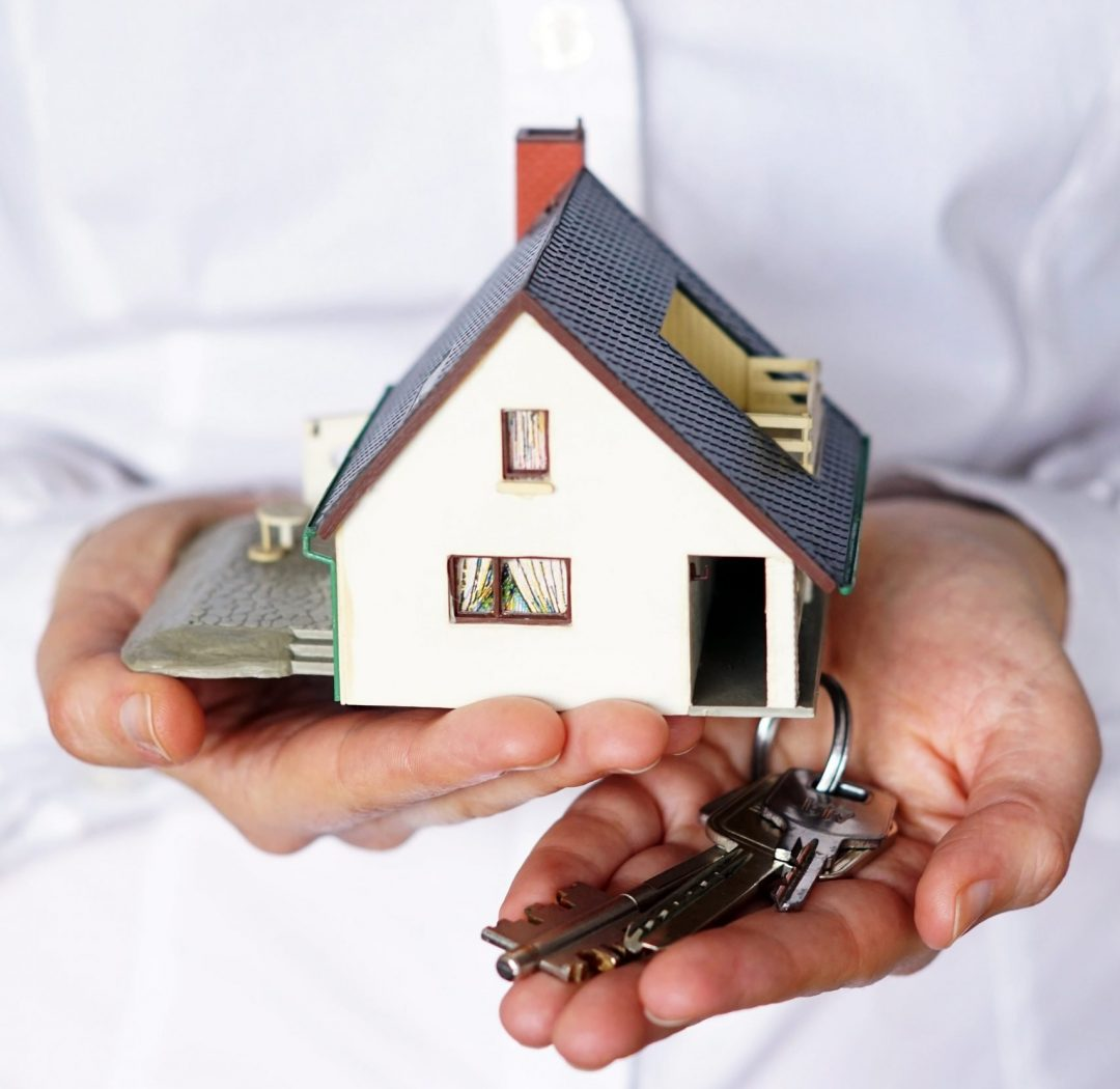 vertical-closeup-shot-person-thinking-buying-selling-house-min